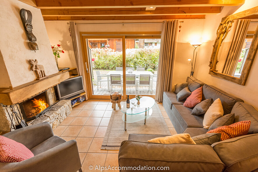 Chalet La Cascade Samoens Living area with deep comfortable sofas and roaring log fire