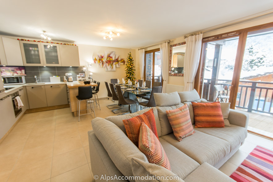 Le Clos F6 Samoens Stunning open plan living kitchen and dining areas with the balcony beyond