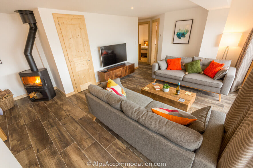 Apartment Marguerite Samoens A cosy log fire is ideal after a fun day in the mountains