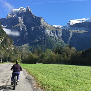 Riding towards the stunning Cirque de Fer a Cheval near Sixt